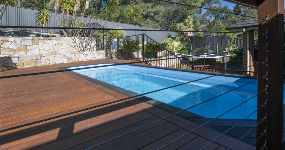 Above ground pools are popular on sloping sites