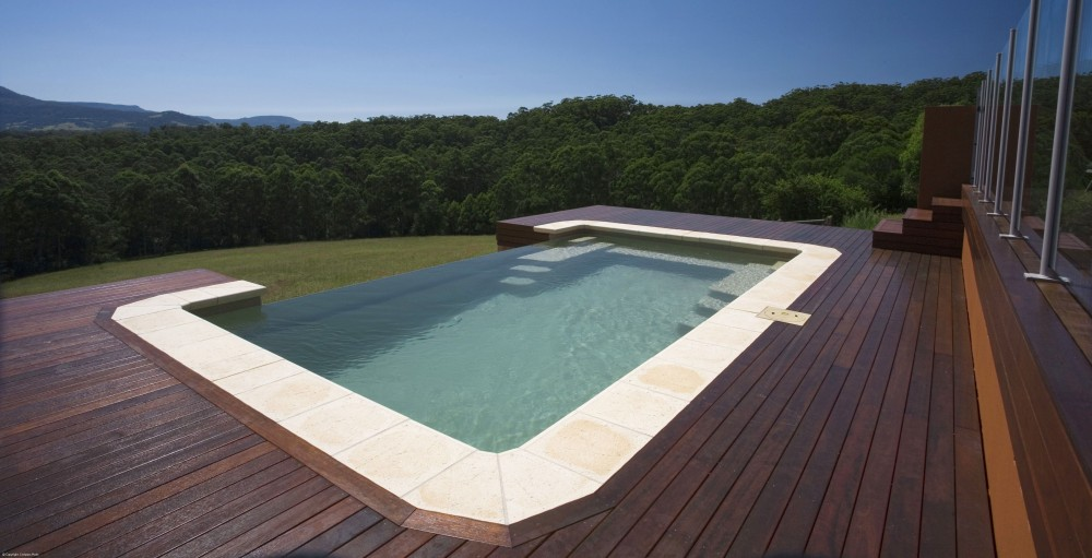 A Compass fibreglass pool with an infinity edge